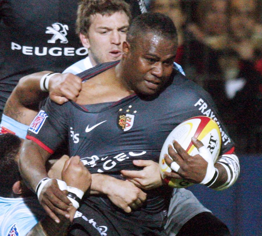 Toulouse winger Rupeni Caucaunibuca stretches the Perpignan defence