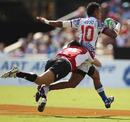 Samoa's Tom Iosefo is tackled by Japan's Shuetsu Narita