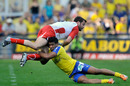 Biarritz fly-half Florian Faure is tackled by Wesley Fofana