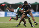 New Zealand's Frank Halai is tackled by Sibusiso Sithole