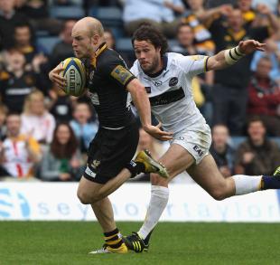 Wasps' scrum-half Joe Simpson races clear to score