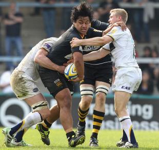 Wasps' Jonah Holmes is halted by Leeds defenders
