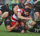 Gloucester's Jonny May is shackled by the Northampton defence