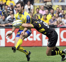 Clermont Auvergne scrum-half Morgan Parra is tackled by La Rochelle's Benjamin Dambielle