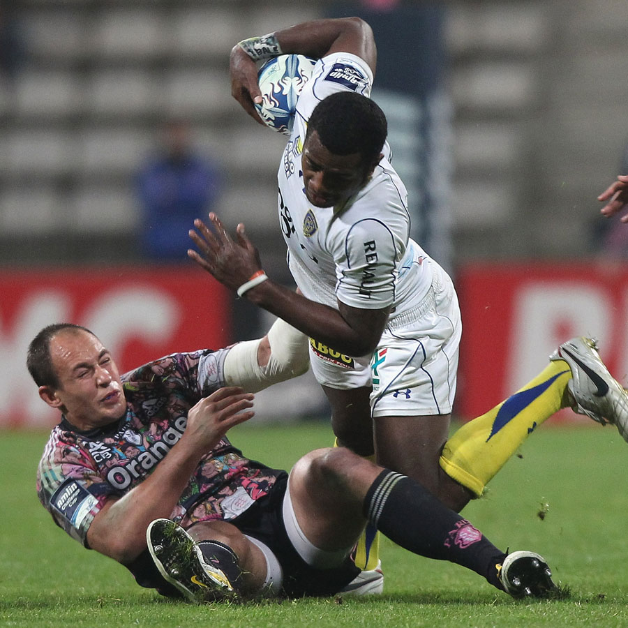 Stade Francais' Sergio Parisse takes down Clermont's Kini Murimurivalu