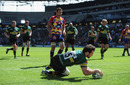 Northampton fullback Ben Foden dives in to score