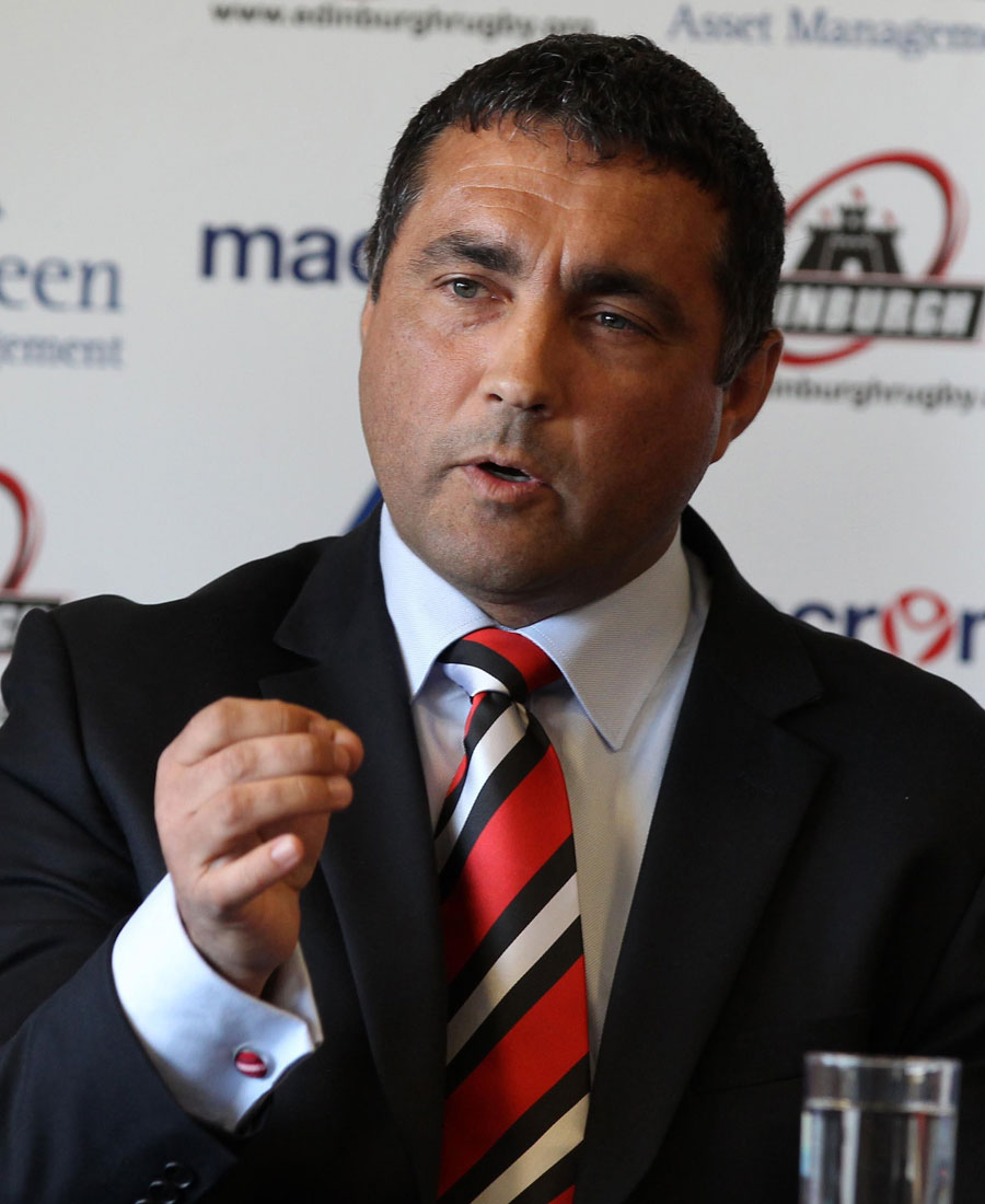 Edinburgh coach Michael Bradley talks to the media