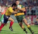 Australia's Joe Roff takes on the Romania defence