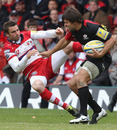 Saracens' Schalk Brits fends off Gloucester's Nicky Robinson
