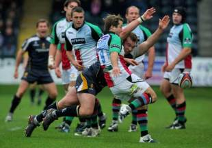 Harlequins scrum half Andy Gomarsall clears the ball despite the dive of Matt Mullan during the EDF Energy Cup match between Worcester Warriors and Harlequins at Sixways in Worcester, England  on November 2, 2008.