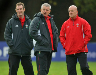 Wales Head coach Warren Gatland (C) talks with assistant coaches Robert Howley (L) and Shaun Edwards during Wales Rugby Union training at Sophia Gardens in Cardiff, Wales on November 3, 2008.