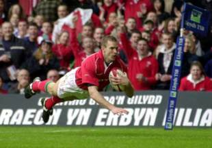 Wales wing Dafydd James dives in to score against Italy at the Millennium Stadium, March 2 2002