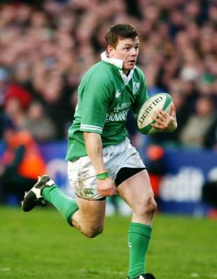 Brian O'Driscoll springts in for one of his three scores against Scotland at Lansdowne Road, March 2 2002
