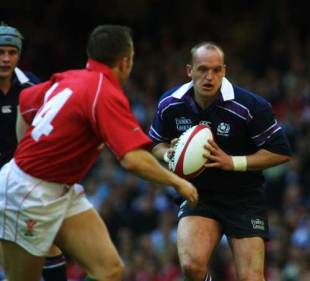 Scotland fly-half Gregor Townsend takes on Rhys Williams of Wales during a Six nations clash at the Millennium Stadium, April 6 2002