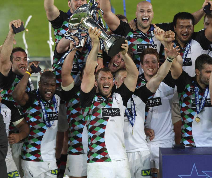 Harlequins celebrate with the Amlin Challenge Cup silverware