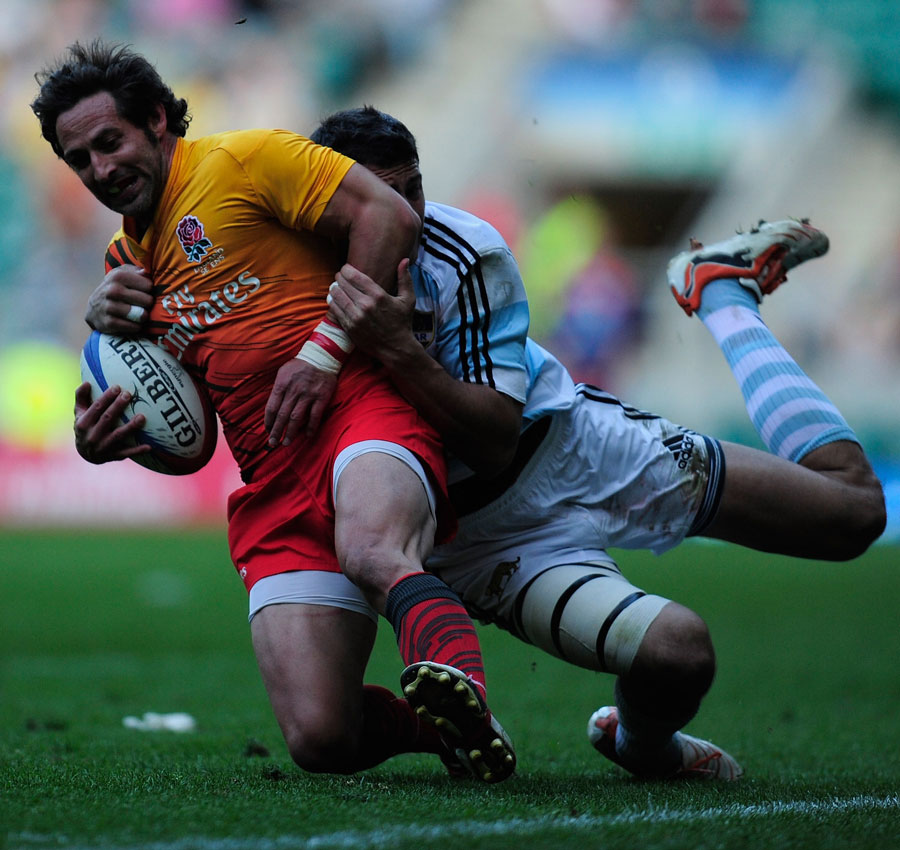 England's Ben Gollings is caught by an Argentina defender
