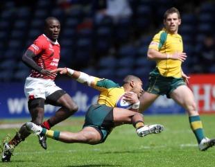Australia's Daniel Yakapo slips during the match against Kenya