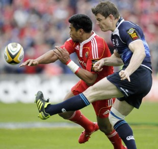 Leinster's Brian O'Driscoll comes under pressure from Munster's Lifimi Mafi