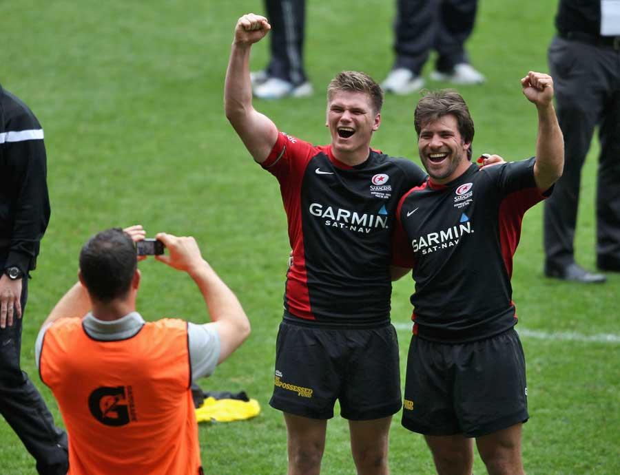 Andy Farrell takes a picture of son Owen and Schalk Brits
