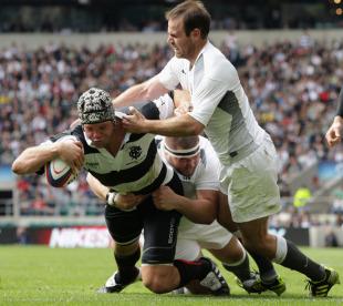 The Barbarians' Joe Van Niekerk powers through the England defence