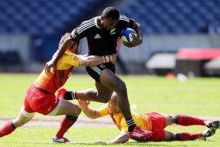 New Zealand's David Raikuna splits the England defence