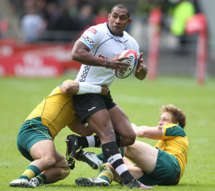 Fiji's Apolosi Satala looks for an offload against Australia