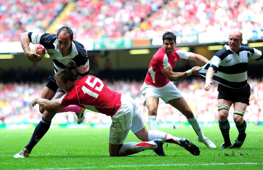 Barbarians captain Sergio Parisse shrugs off Morgan Stoddart's tackle to score
