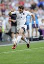 Toulouse winger Maxime Medard kicks ahead