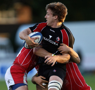 Canada's Chauncey O'Toole is tackled by Russian defenders, Esher RFC, June 8, 2011
