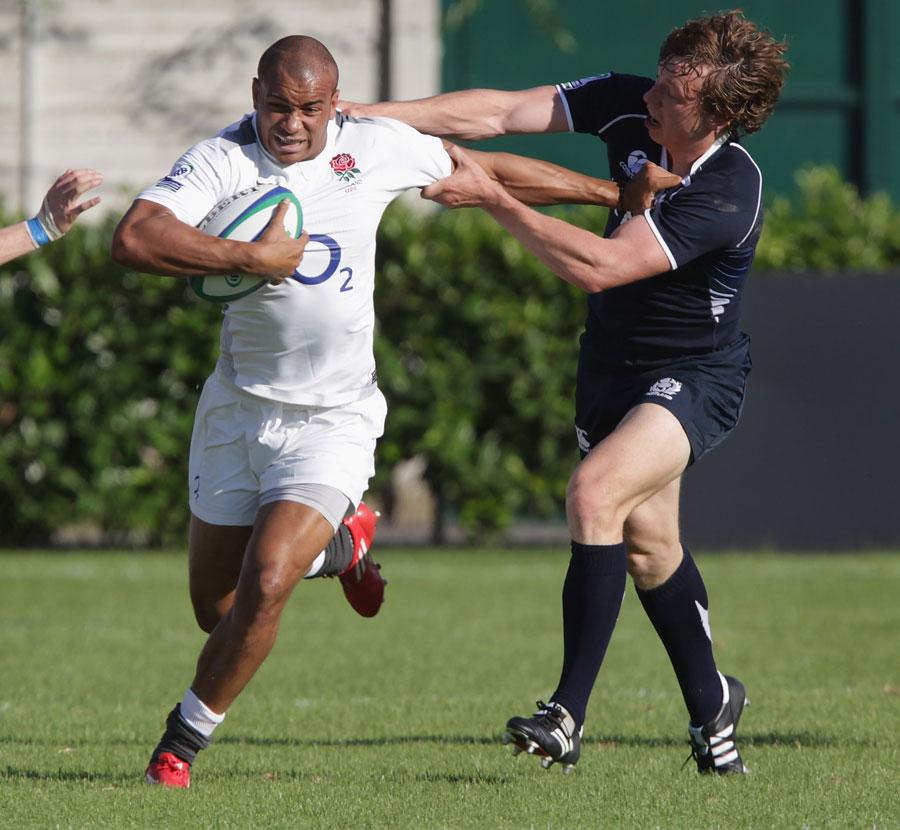 England's Jonathan Joseph hands off Hamish Watson