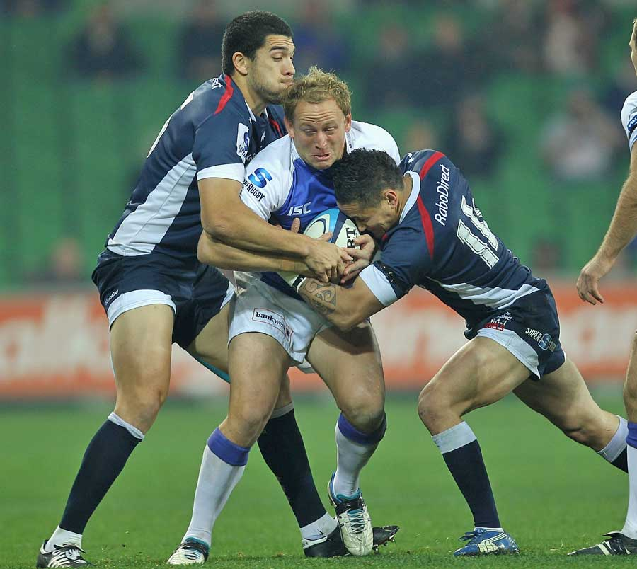 The Rebels gang up on the Western Force's Brett Sheehan