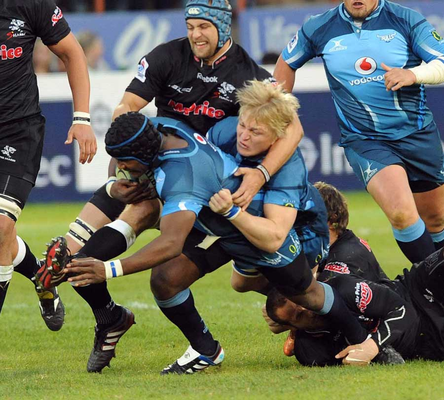The Bulls' Chilliboy Ralepelle is hauled to the ground
