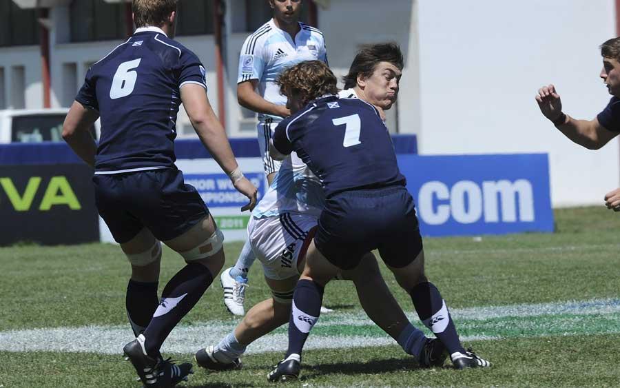 Argentina prop Ignacio Saenz tries to burst through a tackle