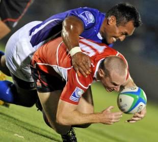 Samoa's Uale Mai tackles Japan's Shaun Webb