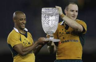 George Gregan and Stirling Mortlock  hold the Cook Cup after defeating England at the Telstra Dome on June 17, 2006