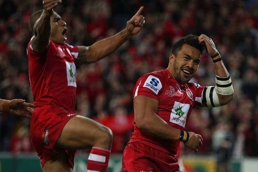 The Reds winger Digby Ioane celebrates his try