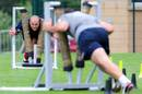 France No. 8 Julien Bonnaire puts the shove on during training