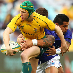 Australia's Matt Giteau offloads against Samoa, Australia v Samoa, ANZ Stadium, Sydney, Australia, July 17, 2011
