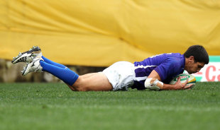 Samoa fullback Paul Williams touches down