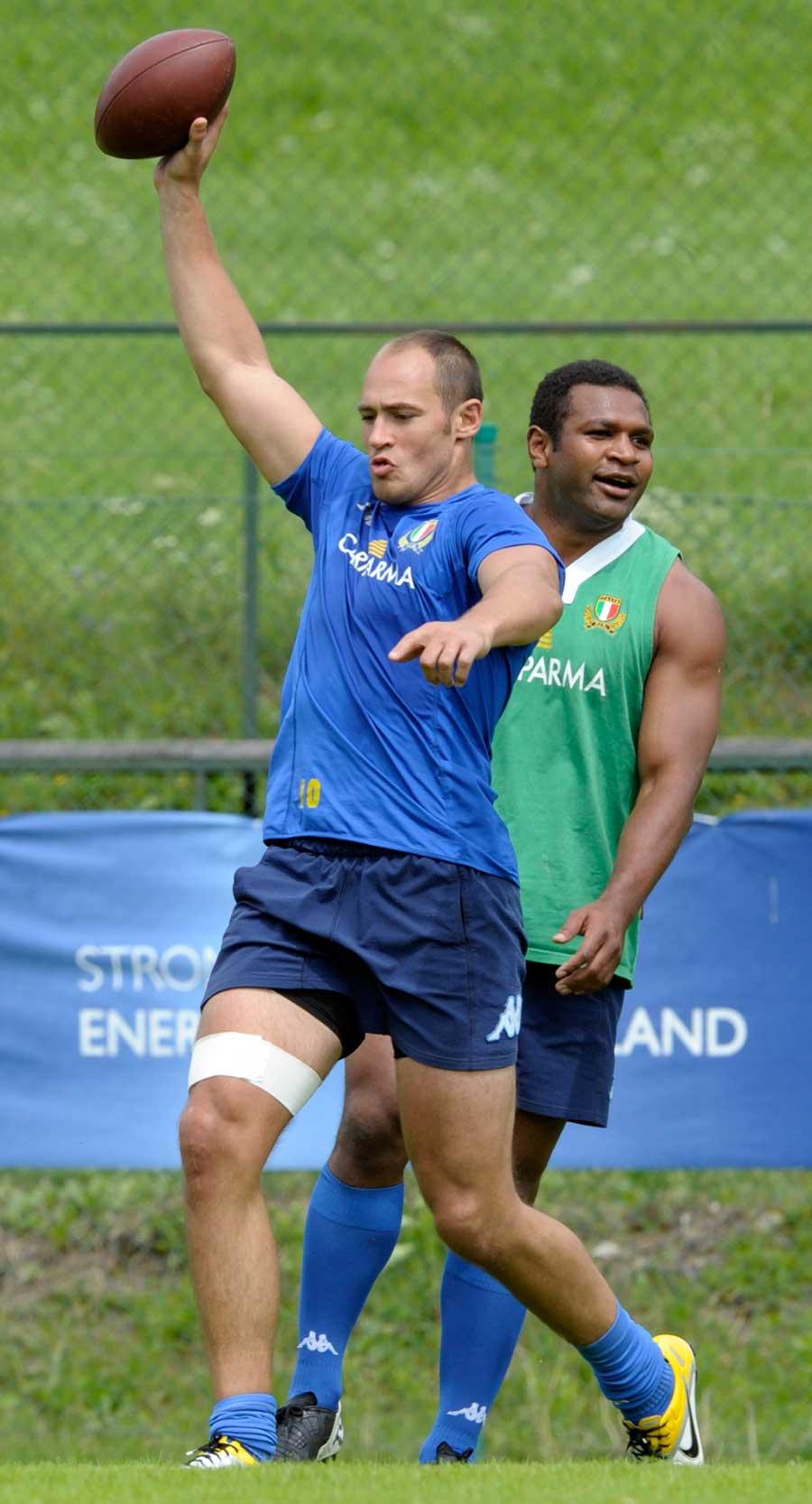 Italy's Sergio Parisse stretches during training