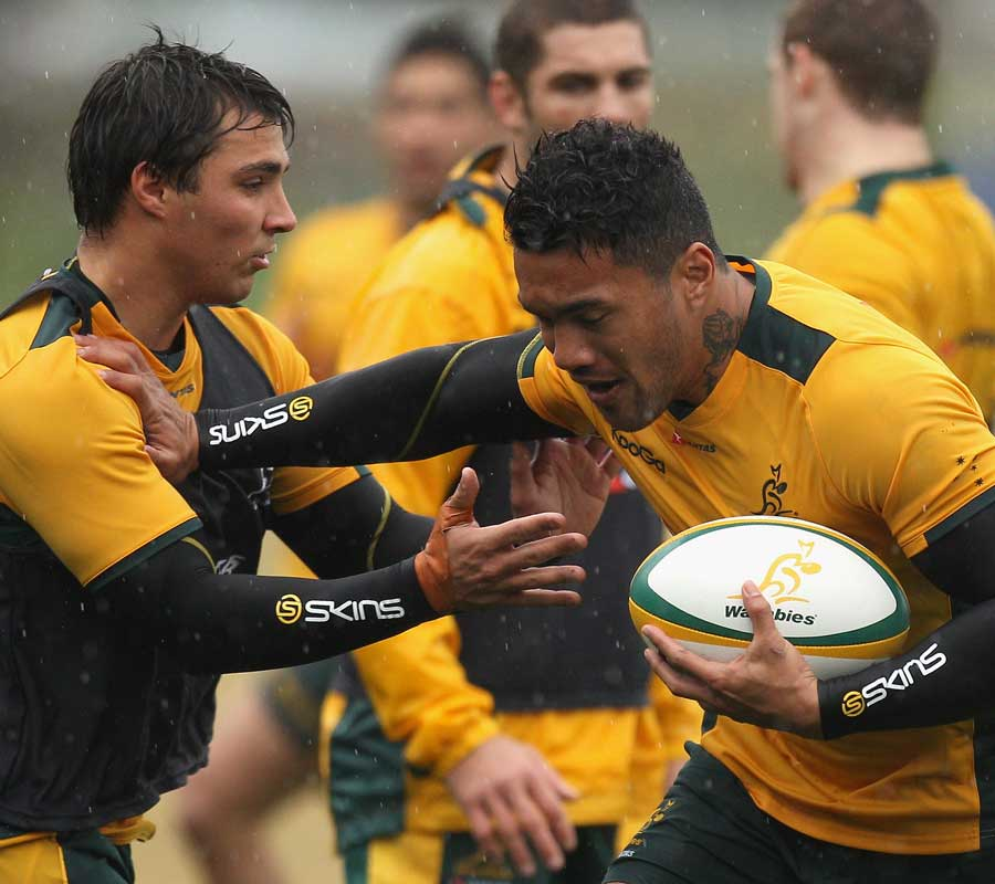 Australia wing Digby Ioane hands off Nick Phipps