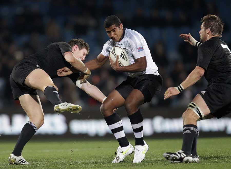 Fiji's Iliesa Keresoni vies with Colin Slade