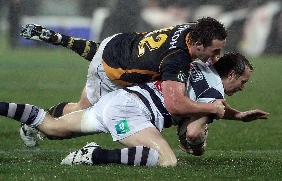 Wellington centre Michael Hobbs tackles Brent Ward