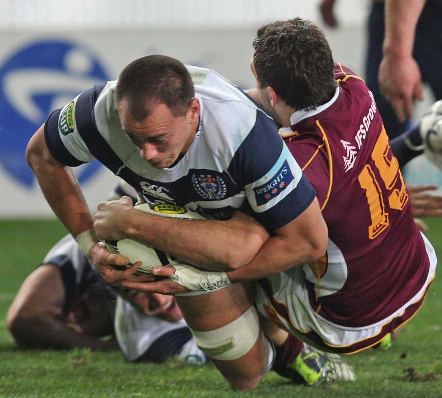 Auckland's Chris Lowrey crosses for a try