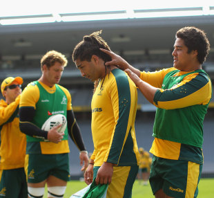 Saia Fainga'a is assisted by Wallabies team-mate Pek Cowan