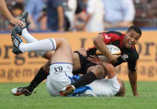 Saracens' Marcus Watson is held up by his opponent