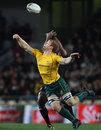 Australia flanker David Pocock vies for a high ball