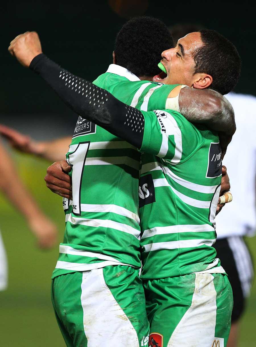 Manawatu's Aaron Smith celebrates with Tomasi Cama