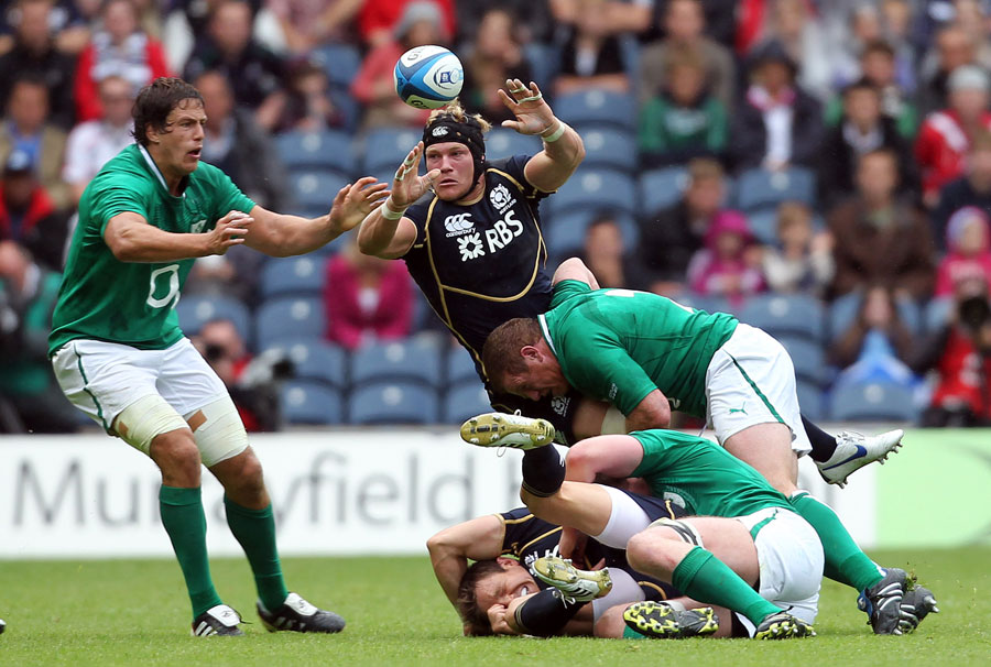 Scotland's Ross Rennis tries to claim a loose ball