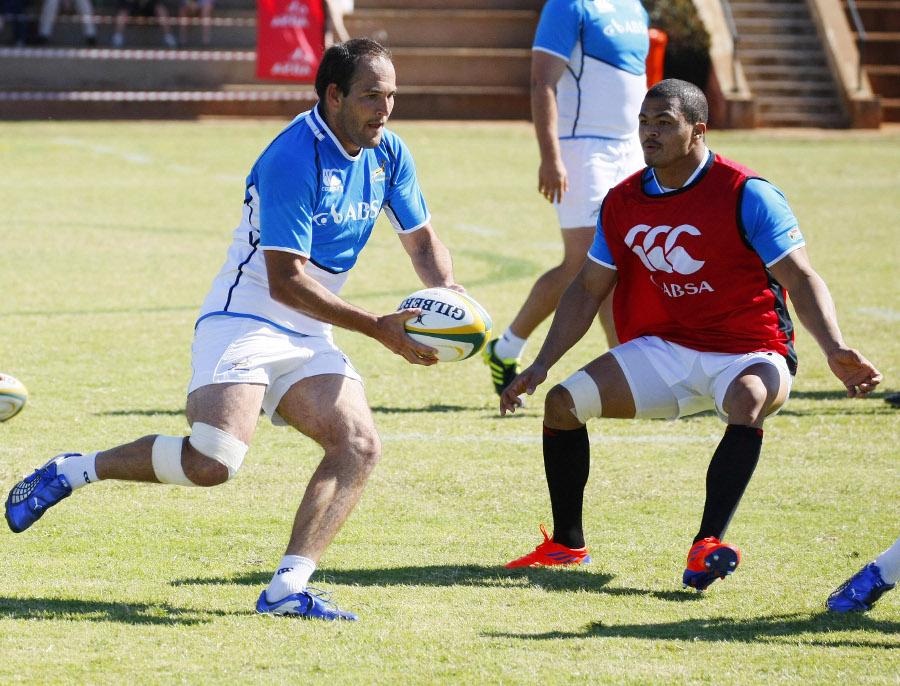South Africa's Fourie du Preez tries to get past Juan de Jongh